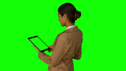 Businesswoman using her tablet pc Live Action