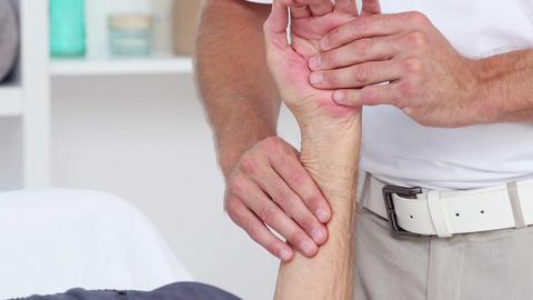 Doctor massaging his patients wrist Footage