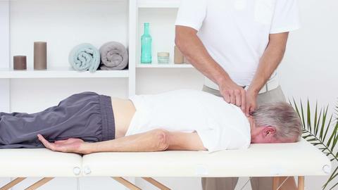 Doctor Massaging His Patients Neck stock footage