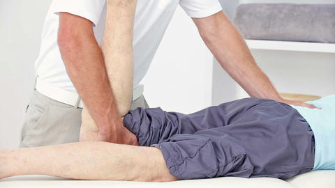 Doctor Stretching His Patients Leg stock footage