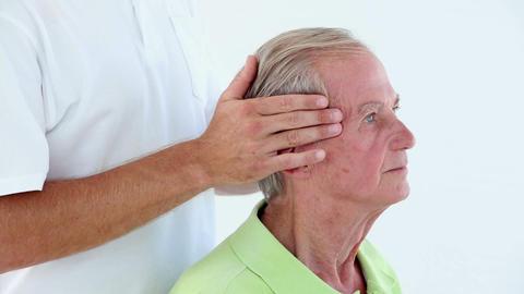 Doctor Massaging His Patients Head stock footage