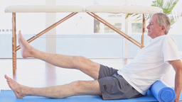 Patient Raising His Legs stock footage