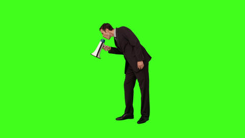 Businessman standing and shouting with megaphone Footage