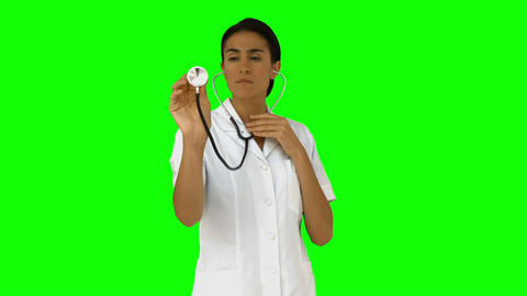 Nurse listening with her stethoscope Live Action