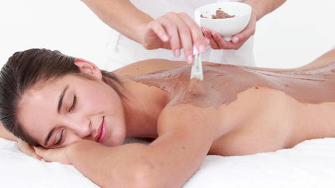 Woman lying on massage table getting treatment Footage