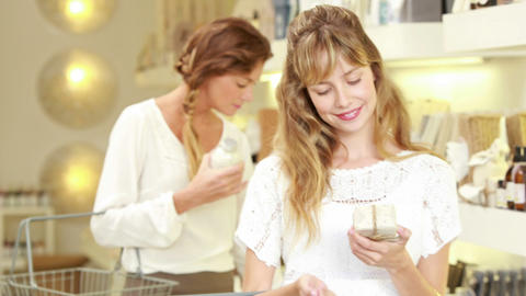 Happy Blonde Selecting Beauty Product At Pharmacy stock footage