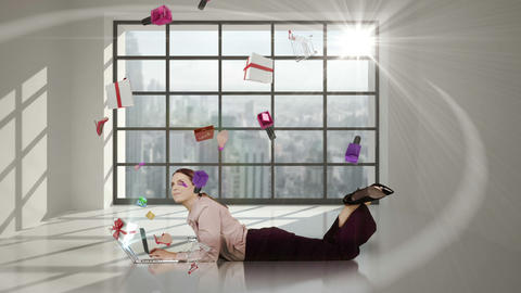 Pretty woman lying on floor and looking at e-shopping offer on laptop Animation