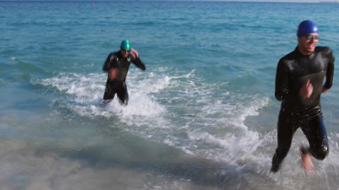 Swimmers running in the ocean Footage