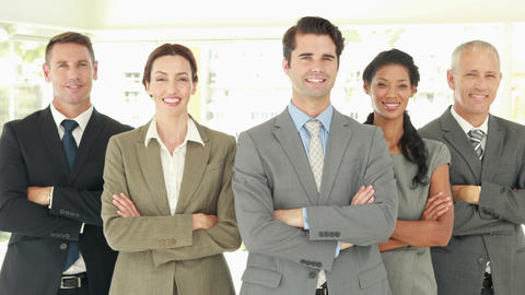 Smiling business people looking at camera with arms crossed Footage