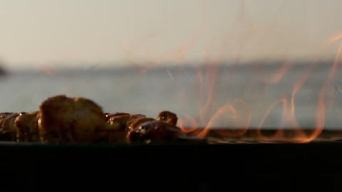 Close up view of skewers on the barbecue Live Action