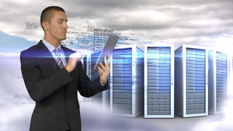 Businessman using tablet computer in front of servers towers on sky background Animation