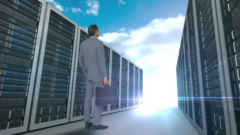 Businessman looking at server tower on cloudy sky background Animation