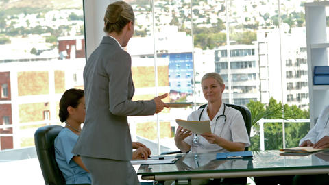 Businesswoman picking medical folder during medical meeting Footage