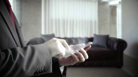 Businessman using smartphone in living room Animation