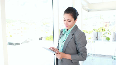 Happy businesswoman using tablet computer Live Action