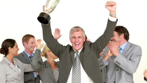 Businessman holding cup and cheering with his colleagues Footage