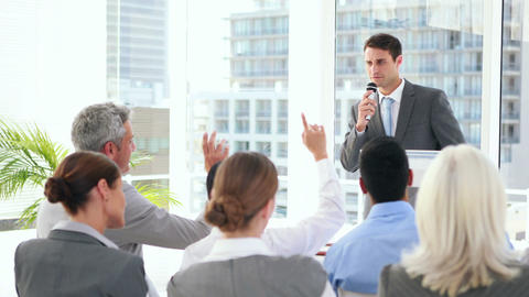 Business people asking question during presentation Footage