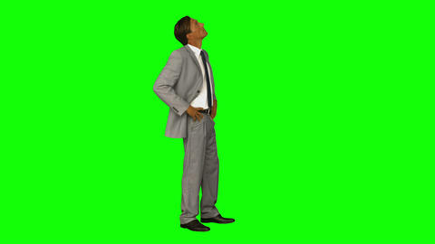 Businessman standing with hands on hips Footage