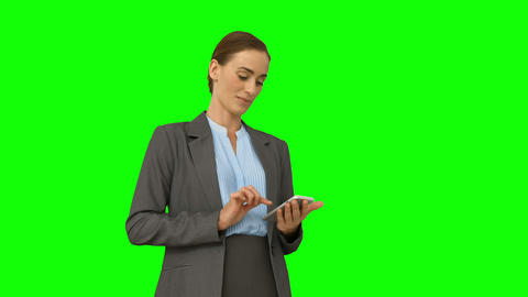Serious businesswoman using her smartphone Footage