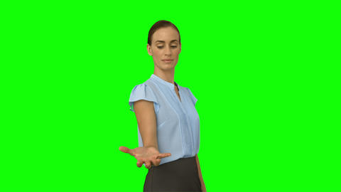 Businesswoman presenting with her hand Footage