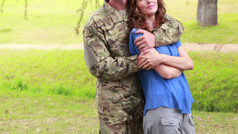 Happy soldier hugging his wife Footage