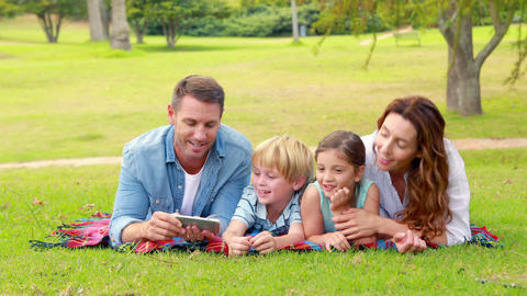 Happy family using tablet computer Footage