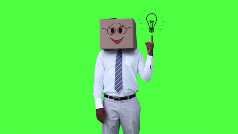 Happy anonymous businessman with box on head and pointing cartoon light bulb Footage