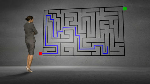 Businesswoman looking at grey wall with maze Animation