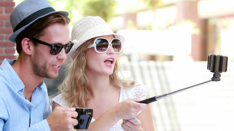 Cute Couple Using A Selfie Stick stock footage