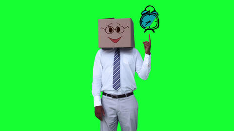 Businessman with a carton on the head pointing at an animated alarm clock Footage