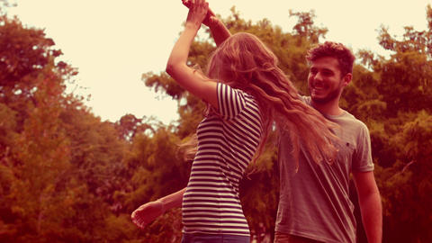 Happy cute couple dancing in the park Footage