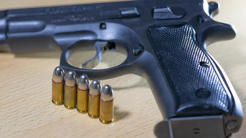 Pistol with loose ammunition Stock Video Footage