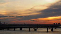 Cloudy Sunset Over The River Bridge In The City Timelapse stock footage