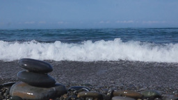 Ocean Waves Rolls On The Pebble Beach stock footage