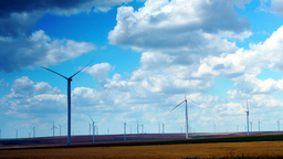 Wind Turbines With Turquoise Sky, Green Energy. Time Lapse, Zoom In Footage