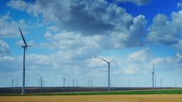 Wind Turbines In A Wheat Field, Time Lapse, Zoom In Footage