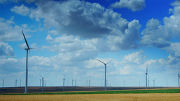 Wind Turbines In A Wheat Field, Time Lapse, Zoom Out Footage