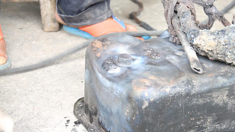 Surface Preparing The Crack of Oil Pan And Electric Welding Footage
