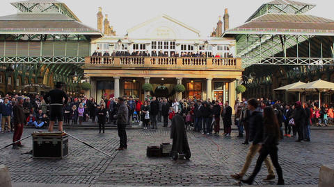 Covent Garden in London - people watching entertainer Footage