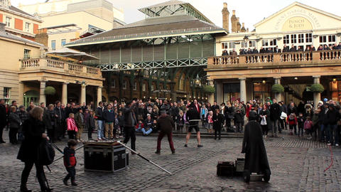 Covent Garden in London - people watching entertainer and some getting involved Footage
