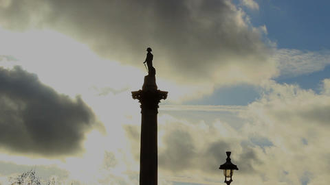 Tip Of Nelson's Column On A Cloudy Sky Background - Time Lapse stock footage