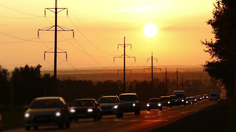 cars on road against sunset - zoom timelapse Footage