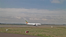 An Ethiopian Airlines flight about to take off on the runway at Bole Internation Footage