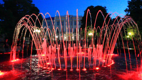 Colored Red Fountains In City Park stock footage