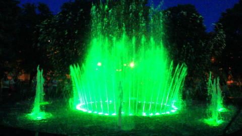 colored fountains in city park Footage