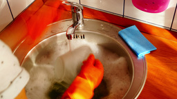 Woman With Orange Gloves Is Dishwashing, Time Lapse,Zoom In Footage