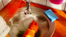 Woman With Orange Gloves Is Dishwashing, Time Lapse,Zoom Out Footage