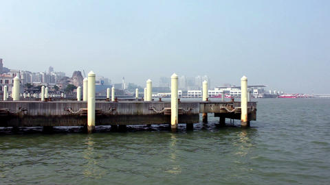 Mooring posts at Macau Fisherman's Wharf and view of Outer Harbour Ferry Termina Footage