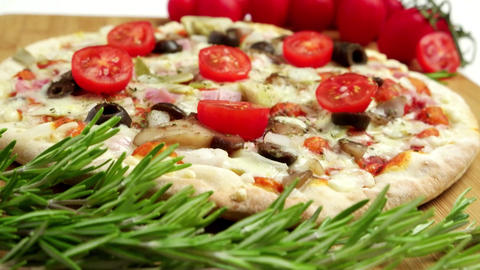 Pizza with bacon, olives and tomato Footage