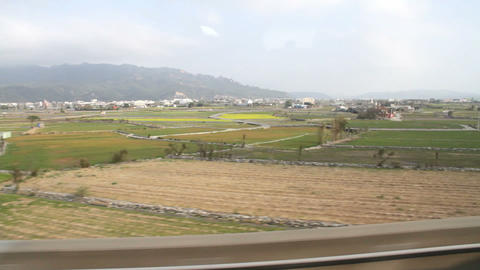 Taiwan Rural Scene Out of The Window of a Driving High-Speed Train. HD Live Action